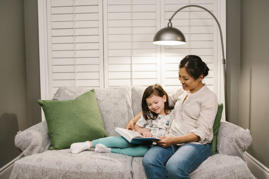 Women and daughter on couch
